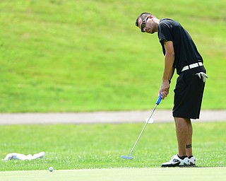 YOUNGSTOWN, OHIO - AUGUST 23, 2014: Brian Newell follows through on his putt on the back 9 of the Youngstown Country Club during the Vindy Greatest Golfer Tournament. (Photo by David Dermer/Youngstown Vindicator)