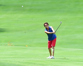 YOUNGSTOWN, OHIO - AUGUST 23, 2014: Jill Harmon follows through on her approach shot front 9 of the Youngstown Country Club during the Vindy Greatest Golfer Tournament. (Photo by David Dermer/Youngstown Vindicator)
