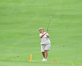 YOUNGSTOWN, OHIO - AUGUST 23, 2014: Patty Brant follows through on her approach shot on the front 9 of the Youngstown Country Club during the Vindy Greatest Golfer Tournament. (Photo by David Dermer/Youngstown Vindicator)