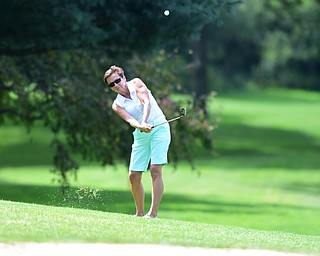 YOUNGSTOWN, OHIO - AUGUST 23, 2014: Pam Volosin chips onto the green from the fairway on the front 9 of the Youngstown Country Club during the Vindy Greatest Golfer Tournament. (Photo by David Dermer/Youngstown Vindicator)