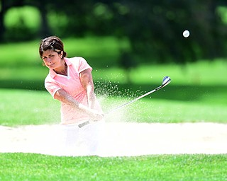 YOUNGSTOWN, OHIO - AUGUST 23, 2014: Felicia Drevna shoots out of the bunker on the front 9 of the Youngstown Country Club during the Vindy Greatest Golfer Tournament. (Photo by David Dermer/Youngstown Vindicator)