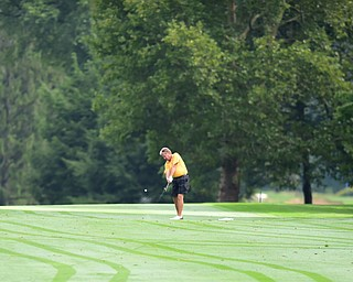 WARREN, OHIO - AUGUST 23, 2014: Dave Tabak of Poland follows through on his approach shot on the 1st hole Saturday morning at Trumbull Country Club during the Vindy Greatest Golfer Tournament. (Photo by David Dermer/Youngstown Vindicator)