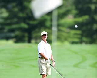 WARREN, OHIO - AUGUST 23, 2014: Ray Duffett of Canfield watches as his ball drops on the green after his approach shot on the 1st hole Saturday morning at Trumbull Country Club during the Vindy Greatest Golfer Tournament. (Photo by David Dermer/Youngstown Vindicator)
