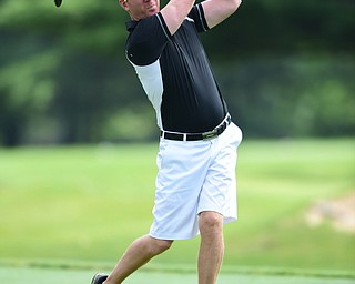 WARREN, OHIO - AUGUST 23, 2014: Brian Carnie follows through on his tee shot on the 2nd hole Saturday morning at Trumbull Country Club during the Vindy Greatest Golfer Tournament. (Photo by David Dermer/Youngstown Vindicator)