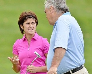 Jeff Lange | The Vindicator  Canfield's Felicia Drevna (left) discusses putting strategy with her father Bob Ciotola at the 8th green of the Lake Club's course during the Vindicator's Greatest Golfer tournament, Sunday.