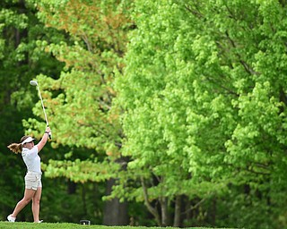 VIENNA, OHIO - MAY 17, 2015: Olivia Taylor of Girard follows through on her tee shot on the 4th hole Sunday afternoon at Squaw Creek Country Club during the Vindy Greatest Golfer junior qualifier. (Photo by David Dermer/Youngstown Vindicator)