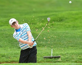VIENNA, OHIO - MAY 17, 2015: Zavier Bokan of McDonald chips out of the bunker and onto the green on the 4th hole Sunday afternoon at Squaw Creek Country Club during the Vindy Greatest Golfer junior qualifier. (Photo by David Dermer/Youngstown Vindicator)