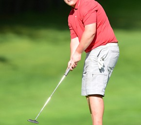 VIENNA, OHIO - MAY 17, 2015: Joey Shushok of Austintown watches as his putt breaks toward the hole on the 17th hole Sunday afternoon at Squaw Creek Country Club during the Vindy Greatest Golfer junior qualifier. (Photo by David Dermer/Youngstown Vindicator)