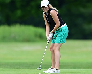 HUBBARD, OHIO - MAY 31, 2015: Alexa Tringhese of Columbiana watches as her ball breaks toward the hole on the 1st hole Sunday afternoon at Pine Lakes. (Photo by David Dermer/Youngstown Vindicator)