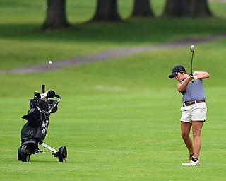 HUBBARD, OHIO - MAY 31, 2015: Tori Augustine follows though on her approach shot on the 1st hole Sunday afternoon at Pine Lakes. (Photo by David Dermer/Youngstown Vindicator)