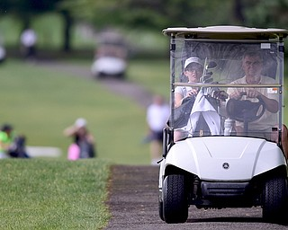 HUBBARD, OHIO - MAY 31, 2015: Emily Koehler is driven to the clubhouse by her father James Koehler at the start of the weather delay Sunday afternoon at Pine Lakes. (Photo by David Dermer/Youngstown Vindicator)