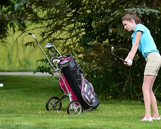 HUBBARD, OHIO - JUNE 26, 2015: Madison Dailey of Mohawk chips toward the green on the 11th hole Friday afternoon at Pine Lakes during a Vindy Greatest Golfer qualifying Tournament. DAVID DERMER | THE VINDICATOR