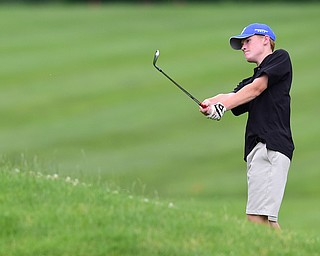 HUBBARD, OHIO - JUNE 26, 2015: Keegan Butler of Austintown chips onto the green on the 13th hole Friday afternoon at Pine Lakes during a Vindy Greatest Golfer qualifying Tournament. DAVID DERMER | THE VINDICATOR