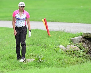 BOARDMAN, OHIO - JULY 1, 2015: Elise Hammond of Columbiana searches for her golf ball after her tee shot on the 9th hole at Mill Creek Golf Course Wednesday afternoon during a Vindy Greatest Golfer qualifying Tournament. DAVID DERMER | THE VINDICATOR