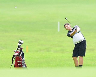 BOARDMAN, OHIO - JULY 1, 2015: Jimmy Fitzgerald of Canfield follows through on his approach shot on the 18th hole at Mill Creek Golf Course Wednesday afternoon during a Vindy Greatest Golfer qualifying Tournament. DAVID DERMER | THE VINDICATOR