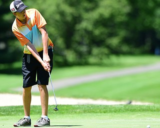 WARREN, OHIO - JULY 16, 2015: Brian Kordupel of Boardman follows through on his putt on the 13th hole Thursday afternoon during a Vindy Greatest Golfer qualifying Tournament. DAVID DERMER | THE VINDICATOR