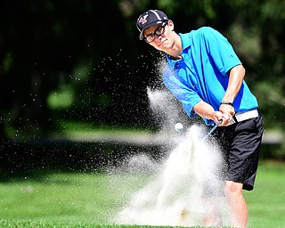 WARREN, OHIO - JULY 16, 2015: Carl Ross of Youngstown chips out of the sand and toward the green on the 8th hole Thursday afternoon during a Vindy Greatest Golfer qualifying Tournament. DAVID DERMER | THE VINDICATOR
