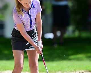 WARREN, OHIO - JULY 16, 2015: Jenna Jacobson of Poland chips out of the sand on the 3rd hole Thursday afternoon during a Vindy Greatest Golfer qualifying Tournament. DAVID DERMER | THE VINDICATOR