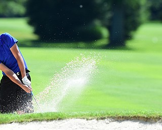 WARREN, OHIO - JULY 16, 2015: Kobe Emery of New Wilmington chips out of the sand on the 5th hole Thursday afternoon during a Vindy Greatest Golfer qualifying Tournament. DAVID DERMER | THE VINDICATOR