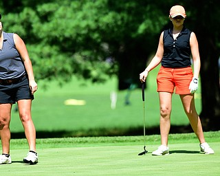 WARREN, OHIO - JULY 16, 2015: Tori Augustine of Boardman reacts after her putt stopped short of the 12th hole Thursday afternoon during a Vindy Greatest Golfer qualifying Tournament. DAVID DERMER | THE VINDICATOR .Sarah Brindley of Howland pictured.