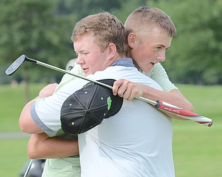 Joey Shushok of Austintown Fitch (front) embraces Ken Keller of Cardinal Mooney after their round in the Greatest Golfer of the Valley junior championship on Sunday at Avalon Lakes Golf & Country Club. Shushok held of Keller to win the 17-U title.