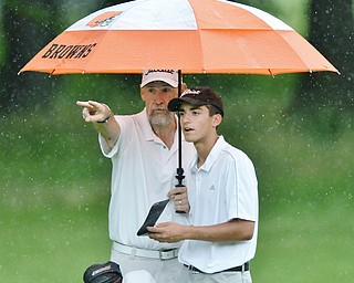 Jeff Lange | The Vindicator JULY 26, 2015 - Girard's Anthony Granziano (right) receives instruction from personal coach John Perry of Houston, Texas during Sunday afternoon's Greatest Golfer of the Valley Junior championship held at Avalon Lakes Golf & Country Club in Howland.
