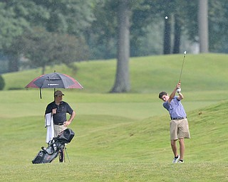Jeff Lange | The Vindicator  JULY 26, 2015 - Jacob Wilson of Kennedy Catholic High School hits an approach shot in the rain during Sunday's Greatest Golfer of the Valley Junior championship held at Avalon Lakes Golf & Country Club in Howland.