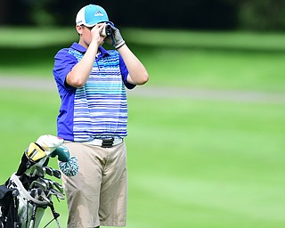 HUBBARD, OHIO - JUNE 26, 2015: Kevin Baker of McDonald uses his range finder on the 18th hole Friday afternoon at Pine Lakes during a Vindy Greatest Golfer qualifying Tournament. DAVID DERMER | THE VINDICATOR