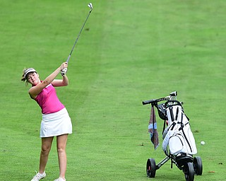 HUBBARD, OHIO - JUNE 26, 2015: Morgan McGowan of Hubbard follows through on her approach shot on the 13th hole Friday afternoon at Pine Lakes during a Vindy Greatest Golfer qualifying Tournament. DAVID DERMER | THE VINDICATOR