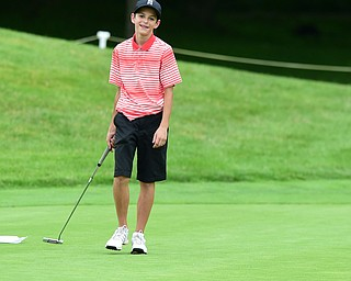 HUBBARD, OHIO - JUNE 26, 2015: Dean Austalosh of Campbell smiles in frustration after missing a putt on the 13th hole Friday afternoon at Pine Lakes during a Vindy Greatest Golfer qualifying Tournament. DAVID DERMER | THE VINDICATOR