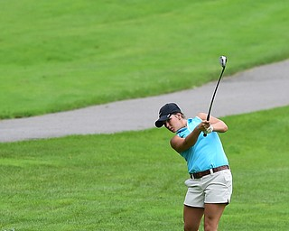 BOARDMAN, OHIO - JULY 1, 2015: Tori Augustine of Boardman follows through on her approach shot on the 8th hole at Mill Creek Golf Course Wednesday afternoon during a Vindy Greatest Golfer qualifying Tournament. DAVID DERMER | THE VINDICATOR