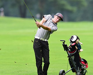 BOARDMAN, OHIO - JULY 1, 2015: Brian Oatridge of Fowler follows through on his approach shot on the 15th hole at Mill Creek Golf Course Wednesday afternoon during a Vindy Greatest Golfer qualifying Tournament. DAVID DERMER | THE VINDICATOR