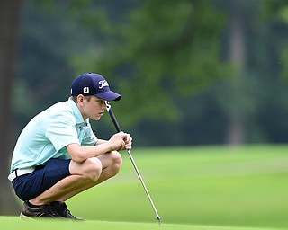 BOARDMAN, OHIO - JULY 1, 2015: Ryan Theis of Mineral Ridge reads the green before his putt on the 15th hole at Mill Creek Golf Course Wednesday afternoon during a Vindy Greatest Golfer qualifying Tournament. DAVID DERMER | THE VINDICATOR