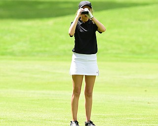 VIENNA, OHIO - MAY 17, 2015: Britney Jonda of Boardman uses her range finder on the 4th hole Sunday afternoon at Squaw Creek Country Club during the Vindy Greatest Golfer junior qualifier. (Photo by David Dermer/Youngstown Vindicator)