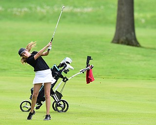 VIENNA, OHIO - MAY 17, 2015: Britney Jonda of Boardman follows through on her swing as she chips from he fairway toward the green on the 4th hole Sunday afternoon at Squaw Creek Country Club during the Vindy Greatest Golfer junior qualifier. (Photo by David Dermer/Youngstown Vindicator)