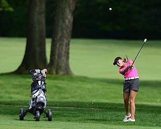 VIENNA, OHIO - MAY 17, 2015: Taylor Vassis of Vienna follows through on her approach shot on the 13th hole Sunday afternoon at Squaw Creek Country Club during the Vindy Greatest Golfer junior qualifier. (Photo by David Dermer/Youngstown Vindicator)