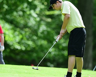 VIENNA, OHIO - MAY 17, 2015: Jacob Dubravcak follows through on his putt on the 13th hole Sunday afternoon at Squaw Creek Country Club during the Vindy Greatest Golfer junior qualifier. (Photo by David Dermer/Youngstown Vindicator)