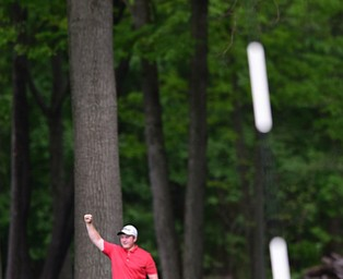 VIENNA, OHIO - MAY 17, 2015: Joey Shushok of Austintown raises his arm in celebration after his golf ball dropped into the hole for a eagle on the par 416th hole Sunday afternoon at Squaw Creek Country Club during the Vindy Greatest Golfer junior qualifier. (Photo by David Dermer/Youngstown Vindicator)