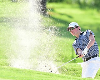 VIENNA, OHIO - MAY 17, 2015: Brian Velasquez of Poland chips out of the bunker and onto the green on the 18th hole Sunday afternoon at Squaw Creek Country Club during the Vindy Greatest Golfer junior qualifier. (Photo by David Dermer/Youngstown Vindicator)