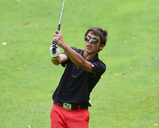 CANFIELD, OHIO - JULY 7, 2015: Jason Paris of Canfield follows through on his approach shot on the 18th hole Tuesday afternoon at Diamondback during a Vindy Greatest Golfer qualifying Tournament. DAVID DERMER | THE VINDICATOR