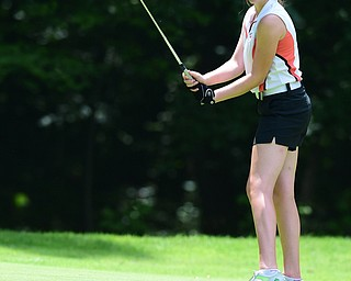 CANFIELD, OHIO - JULY 7, 2015: Sydney Heinbaugh of Youngstown bits her bottom lip after her putt broke just short of the hole on the 15th hole Tuesday afternoon at Diamondback during a Vindy Greatest Golfer qualifying Tournament. DAVID DERMER | THE VINDICATOR