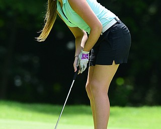 CANFIELD, OHIO - JULY 7, 2015: Sarah Brindley of Howland follows through on her putt on the 15th hole Tuesday afternoon at Diamondback during a Vindy Greatest Golfer qualifying Tournament. DAVID DERMER   THE VINDICATOR