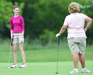 CANFIELD, OHIO - JULY 7, 2015: Madison Dailey of Mohawk smiles while looking at Erika Hoover of Wilmington after her putt on the 11th hole Tuesday afternoon at Diamondback during a Vindy Greatest Golfer qualifying Tournament. DAVID DERMER | THE VINDICATOR