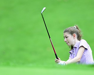 HERMITAGE, PENNSYLVANIA - JUNE 19, 2015: Madison Dailey of Mohawk attempts to chip onto the green from the shot rough on a hill on the 13th hole Friday morning at Tam O' Shanter during the Vindy Greatest Golfer junior qualifier. DAVID DERMER | THE VINDICATOR