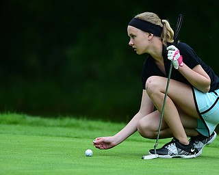 HERMITAGE, PENNSYLVANIA - JUNE 19, 2015: Jenna Jacobson of Poland picks up her marker after placing her ball on the 13th hole Friday morning at Tam O' Shanter during the Vindy Greatest Golfer junior qualifier. DAVID DERMER | THE VINDICATOR
