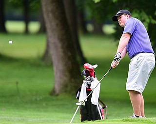 HERMITAGE, PENNSYLVANIA - JUNE 19, 2015: Joey Shushok of Austintown chips onto the green from he shot rough on the 6th hole Friday morning at Tam O' Shanter during the Vindy Greatest Golfer junior qualifier. DAVID DERMER | THE VINDICATOR