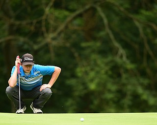 HERMITAGE, PENNSYLVANIA - JUNE 19, 2015: Michael Butch or Ursuline lines up his putt on the 5th hole on the 5th hole Friday morning at Tam O' Shanter during the Vindy Greatest Golfer junior qualifier. DAVID DERMER | THE VINDICATOR