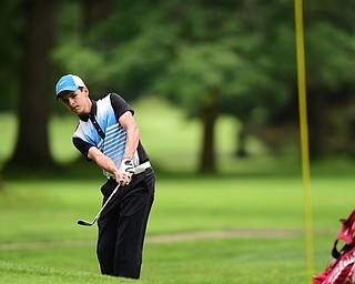 HERMITAGE, PENNSYLVANIA - JUNE 19, 2015: Chris Austalosh of Campbell chips onto the green on the 6th hole Friday morning at Tam O' Shanter during the Vindy Greatest Golfer junior qualifier. DAVID DERMER | THE VINDICATOR