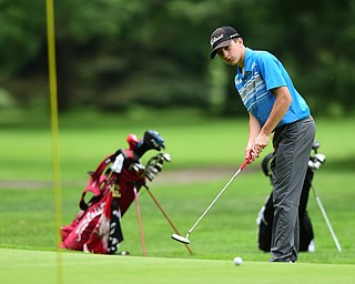 HERMITAGE, PENNSYLVANIA - JUNE 19, 2015: Michael Butch or Ursuline watches as his putt breaks toward the hole on the 6th hole Friday morning at Tam O' Shanter during the Vindy Greatest Golfer junior qualifier. DAVID DERMER | THE VINDICATOR