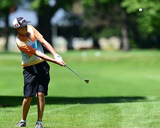 WARREN, OHIO - JULY 16, 2015: Brian Kordupel of Boardman chips onto the green on the 13th hole Thursday afternoon during a Vindy Greatest Golfer qualifying Tournament. DAVID DERMER | THE VINDICATOR